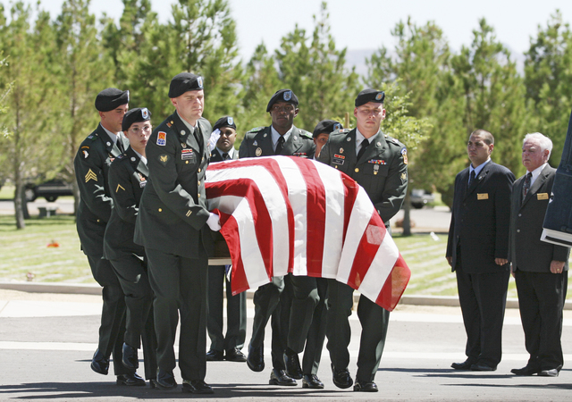 """U.S. Army soldiers from an Honor Guard as they carry the casket of Army Spc. Ignacio """"Nacho"""" Ramirez into the chapel at the Southern Nevada Veterans Memorial Cemetery in Boulder City, Friday, Aug. ..."""