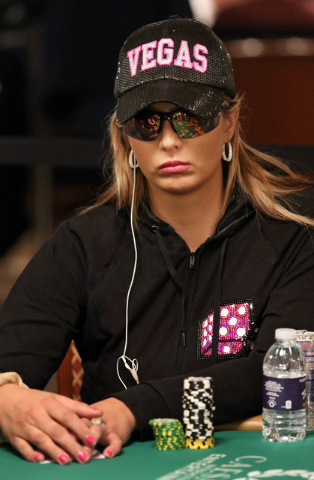 Shannon Stash plays poker during the Casino Employees No-Limit Holdem event at the World Series of Poker at Rio hotel-casino Wednesday, May 27, 2015, in Las Vegas. Wednesday kicked off the start o ...