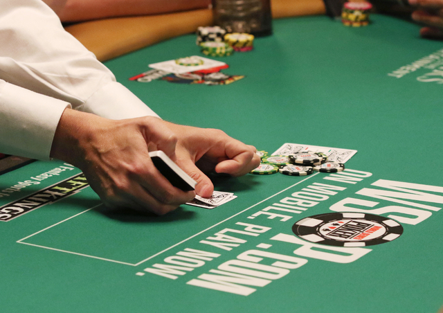 A World Series of Poker dealer deals a hand during the Casino Employees No-Limit Holdem event at Rio hotel-casino Wednesday, May 27, 2015, in Las Vegas. Wednesday kicked off the start of the 46th  ...