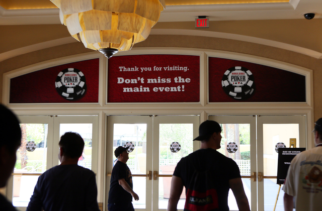 People walk by an entrance to the Rio Convention Center where the World Series of Poker takes places at Rio hotel-casino Wednesday, May 27, 2015, in Las Vegas. Wednesday kicked off the start of th ...