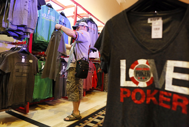 Stephen Dias, of Montreal, shops at a vendor booth at World Series of Poker at Rio hotel-casino Wednesday, May 27, 2015, in Las Vegas. Wednesday kicked off the start of the 46th annual World Serie ...