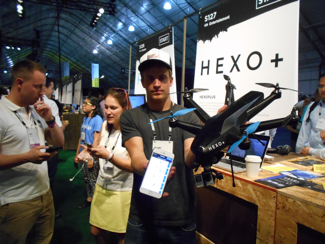Medhi Mugnier of HEXO+ shows the technology behind his company that allows a pre-set control to control drone camera during Collision Conference at World Market Center on Tuesday, May 5, 2015. The ...