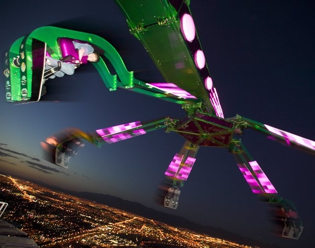 Riders take a spin on Insanity - The Ride atop the Stratosphere Tower, Stratosphere hotel-casino in Las Vegas, March 13, 2005. The ride hangs riders 64 feet out from the observation deck at nearly ...