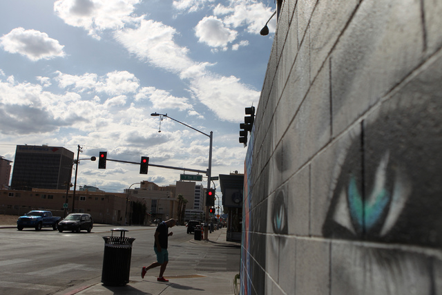 A man walks near the intersection of E. Carson Avenue and S. 7th Street in Las Vegas Sunday, May 17, 2015. (Erik Verduzco/Las Vegas Review-Journal) Follow Erik Verduzco on Twitter @Erik_Verduzco