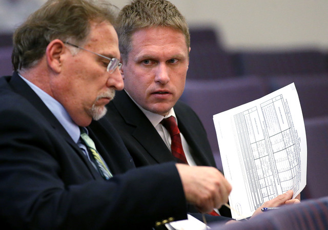 Gov. Brian Sandoval's Chief of Staff Mike Willden, left, and Deputy Chief of Staff Chris Nielsen talk in a hearing at the Legislative Building in Carson City, Nev., on Tuesday, May 5, 2015. A Sena ...