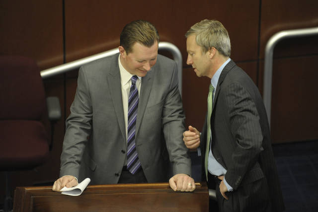 Sens. Ben Kieckhefer, R-Reno, and Greg Brower, R-Reno, huddle on the Senate floor before the afternoon floor session at the Nevada Legislature in Carson City, Thursday, May 14, 2015. (Lisa J. Told ...