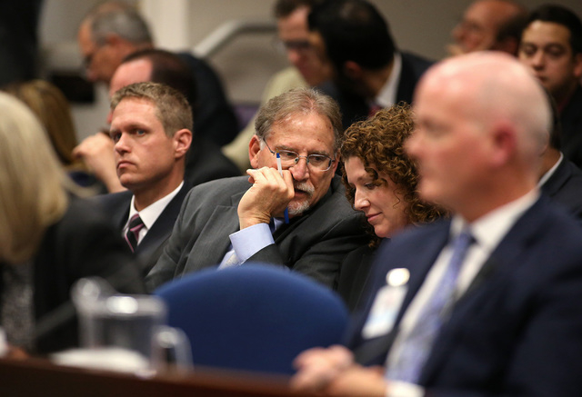 Nevada Gov. Brian Sandoval's top staff, from left, Chris Nielsen, Mike Willden and Michon Martin, listen to testimony in a joint money committee hearing at the Legislative Building in Carson City, ...
