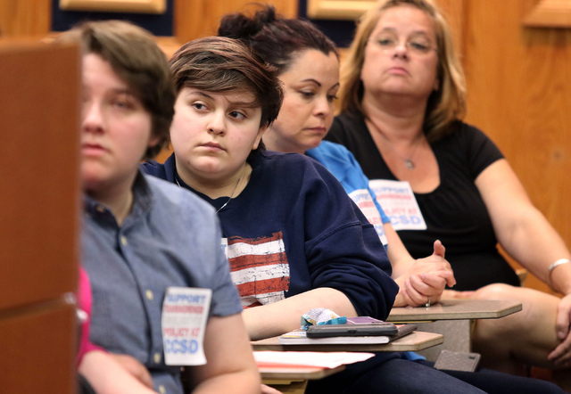 Dave Chaney, second from left, attends a Clark County School Board meeting Thursday, May 28, 2015, in Las Vegas. Chaney was among a group of supporters for transgender students that attended the m ...