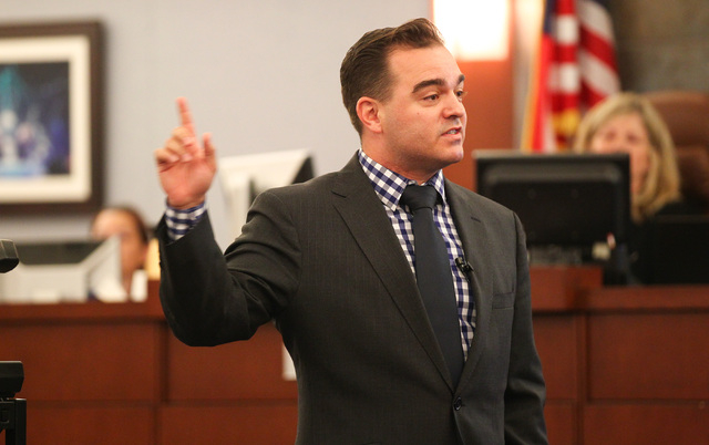 Defense attorney Dustin Marcello speaks during opening statements for the trial of Steven Ficano at the Regional Justice Center in Las Vegas on Wednesday, May 27, 2014. Ficano, who has a medical m ...