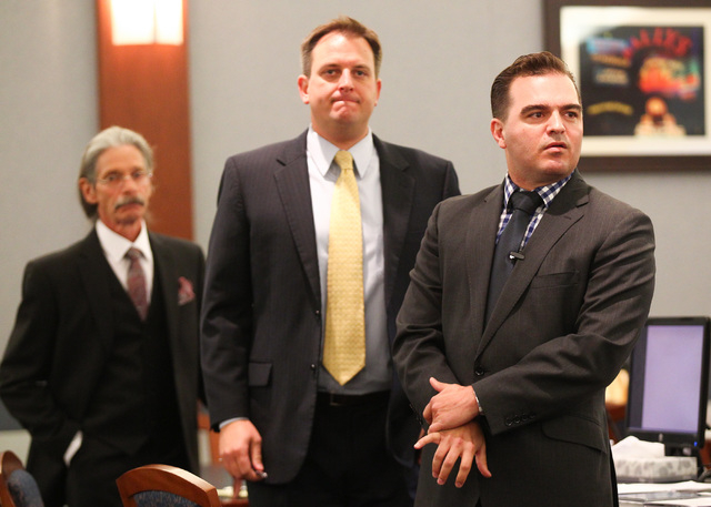 Steven Ficano, who faces felony marijuana charges, is seen left, with attorneys Michael Miceli, center, and Dustin Marcello before the start of his trial at the Regional Justice Center in Las Vega ...