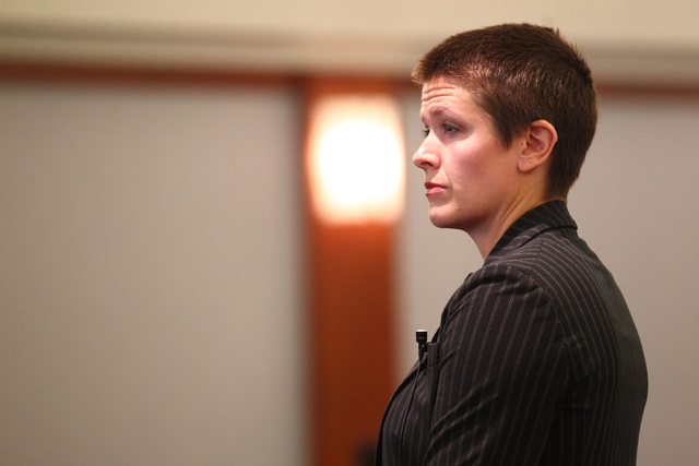 Prosecutor Lindsey Moors is seen before opening statements for the trial of Steven Ficano at the Regional Justice Center in Las Vegas on Wednesday, May 27, 2014. Ficano, who has a medical marijuan ...
