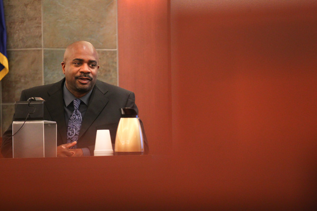 Las Vegas police detective Christopher Cannon testifies during the trial of Steven Ficano at the Regional Justice Center in Las Vegas on Wednesday, May 27, 2014. Ficano, who has a medical marijuan ...