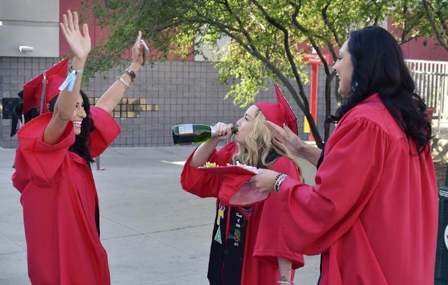 Karen Avila, left, Mackenzie Leonhard (cq), center, and Kristen Herlosky celebrate before the start of UNLV graduation ceremonies at the Thomas & Mack Center at 4505 S. Maryland Parkway in Las Veg ...