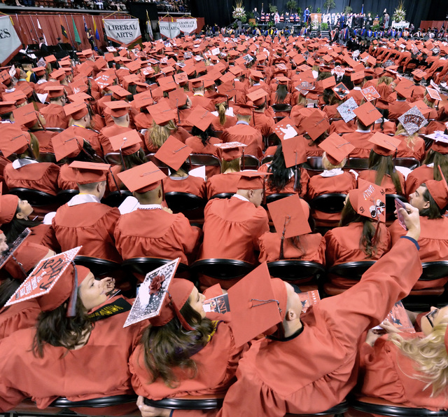 Jeff Oakden, foreground right, takes a selfie with Jenny Sewell, left, and Jeanette Retis during UNLV graduation ceremonies at the Thomas & Mack Center at 4505 S. Maryland Parkway in Las Vegas on  ...
