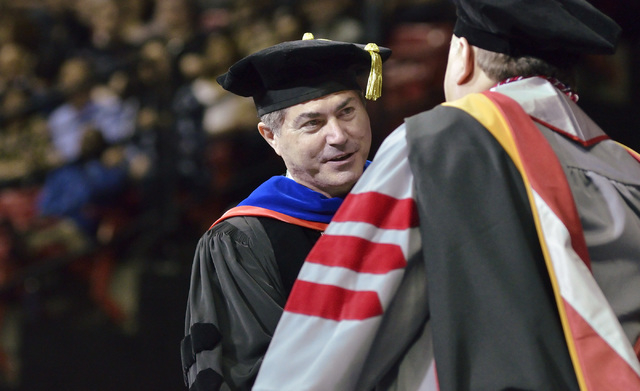UNLV president Len Jessup congratulates a graduate during UNLV commencement ceremonies at the Thomas & Mack Center at 4505 S. Maryland Parkway in Las Vegas on Saturday, May 16, 2015. (Bill Hughes/ ...