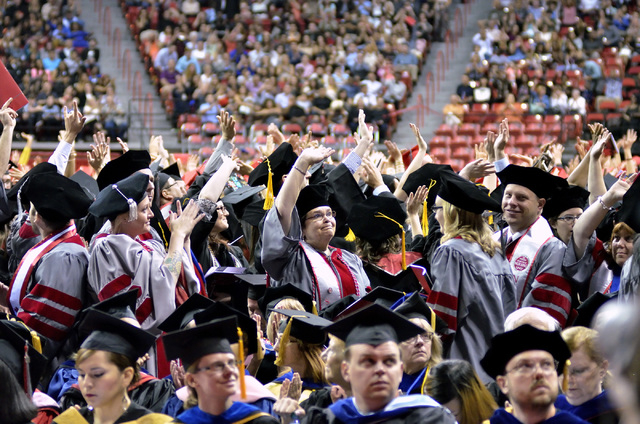 Students wave to the crowd at the Thomas & Mack Center during UNLV graduation ceremonies on the campus at 4505 S. Maryland Parkway in Las Vegas on Saturday, May 16, 2015. (Bill Hughes/Las Vegas Re ...