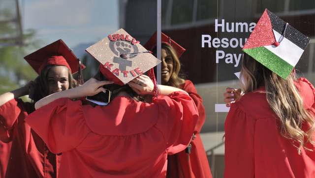Katelynn Calavan, left, and Dalia Marchoud check their caps and gowns before UNLV graduation ceremonies at the Thomas & Mack Center at 4505 S. Maryland Parkway in Las Vegas on Saturday, May 16, 20 ...