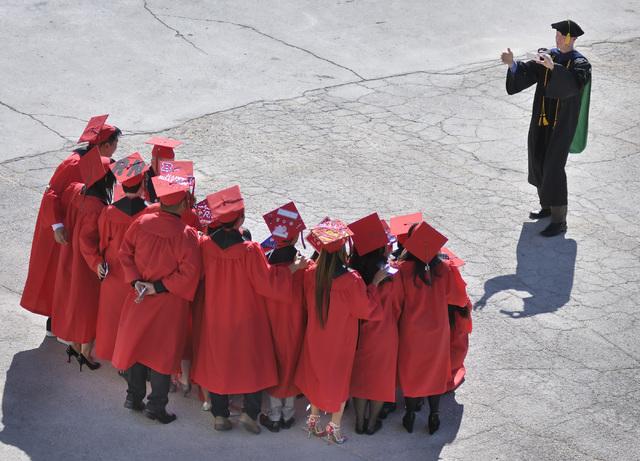 Biomechanics professor John Mercer takes a shot of students before UNLV graduation ceremonies at the Thomas & Mack Center at 4505 S. Maryland Parkway in Las Vegas on Saturday, May 16, 2015. (Bill  ...