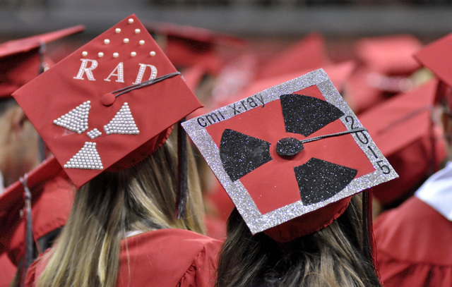 Radiological sciences majors Kristie Lavasseur, left, and Chrissie Choa are shown during UNLV graduation ceremonies at the Thomas & Mack Center at 4505 S. Maryland Parkway in Las Vegas on Saturday ...