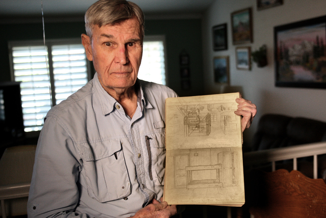 WWII veteran and POW, Carroll Knutson shows a sketch Tuesday, April 21, 2015, that he did of his bunk, one of many from his Wartime Log that he kept during his time as a prisoner in Stalag Luft 3. ...