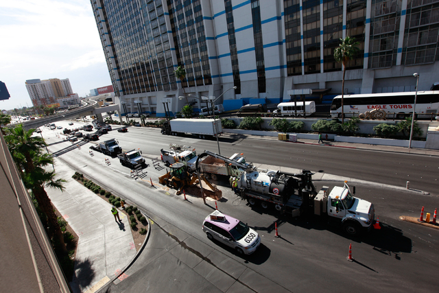 Crews work on containing a water main break on Flamingo Road outside of Bally's and The Cromwell hotel-casinos, near Las Vegas Boulevard South, on Monday morning, May 4, 2015. (Chase Stevens/Las V ...