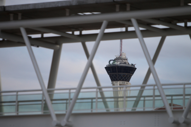 Dark clouds are seen in the background of the Stratosphere casino-hotel in Las Vegas Sunday, Feb. 22, 2015. (Erik Verduzco/Las Vegas Review-Journal)