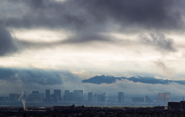 A portion of the Las Vegas Strip is seen as clouds hang above the valley on Monday morning, March 2, 2015. (Chase Stevens/Las Vegas Review-Journal)