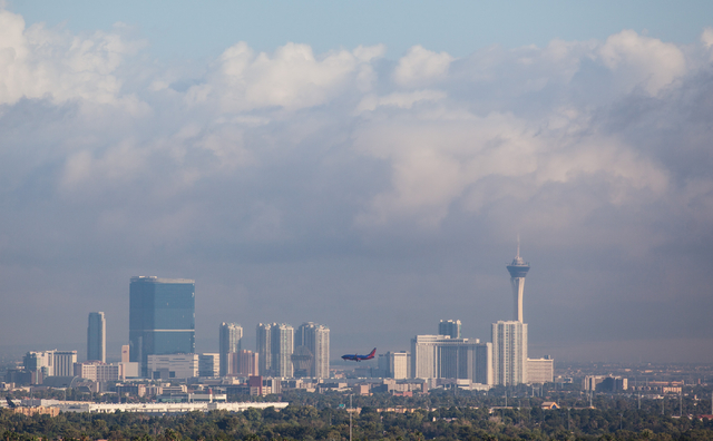 Clouds hover above the Las Vegas Valley as seen from Green Valley Ranch on Tuesday, Sept. 9, 2014. (Chase Stevens/Las Vegas Review-Journal)