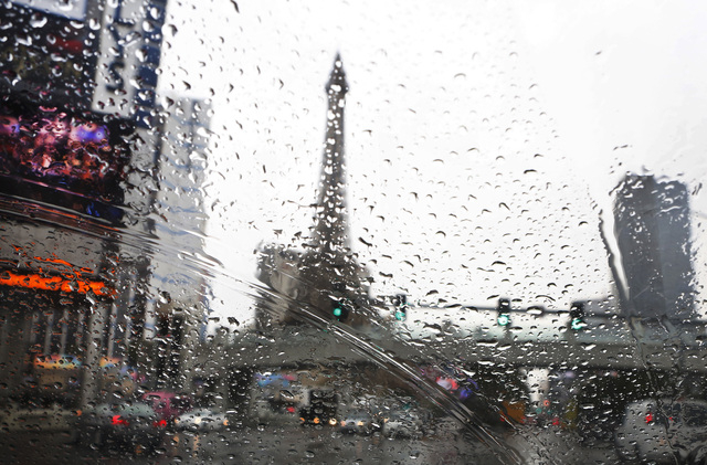 In this photo taken though rain drops on a car window shown Paris Hotel and Casino on Las Vegas Boulvard on Friday, Dec. 12, 2014. (Bizuayehu Tesfaye/Las Vegas Review-Journal)