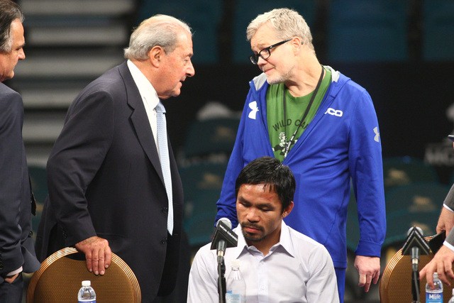 Promoter Bob Arum, left, speaks with trainer Freddie Roach following Manny Pacquiao's defeat by Floyd Mayweather Jr. after their welterweight unification boxing match at the MGM Grand Garden Arena ...