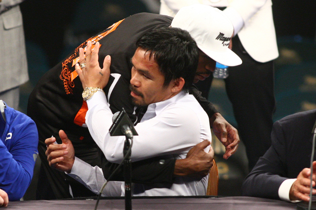 Floyd Mayweather Jr. hugs Manny Pacquiao following Mayweather's unanimous win over Pacquiao in their welterweight unification boxing match at the MGM Grand Garden Arena in Las Vegas on Saturday, M ...