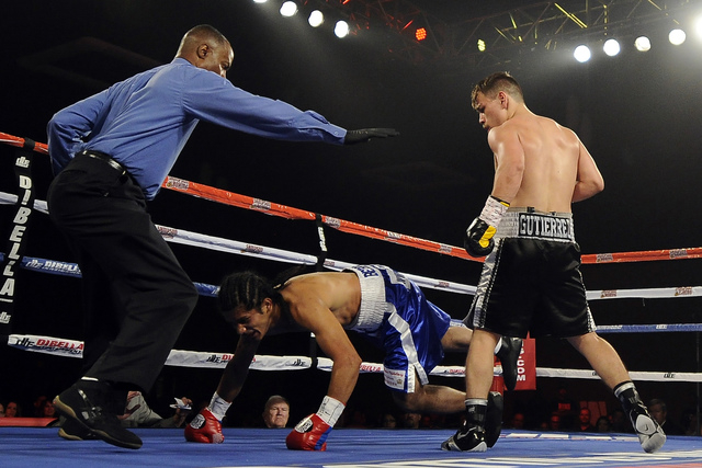 Las Vegas boxer Jesus Gutierrez, right, knocks out Pablo Becerra in the first round of their lightweight bout at the Tropicana Hotel Pavilion in Las Vegas Saturday, May 31, 2014. (Josh Holmberg/La ...