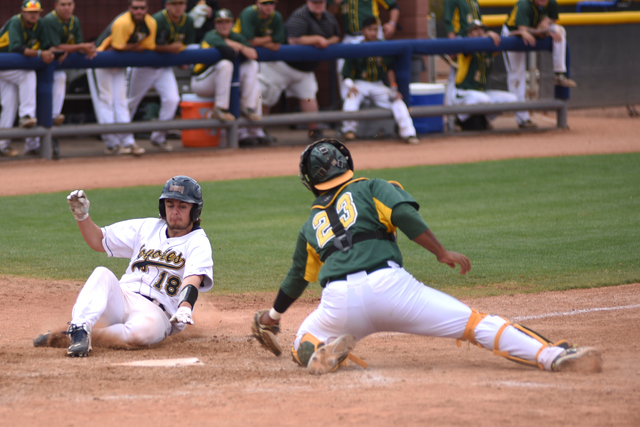 College of Southern Nevada's Mason Hayes (18) slides in for a score against Yavapai College during their Western District Championship game played at Morse Stadium on the CSN campus in Henderson,  ...