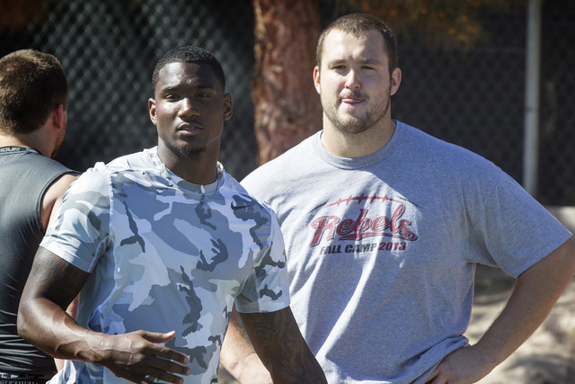 Former UNLV football players receiver Devante Davis,left and lineman Brett Boyko during Rebel's pro day at Rebel Park on the UNLV campus on Thursday, March 12, 2015. Around 25 players conducted dr ...