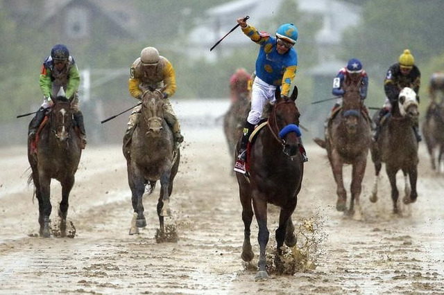May 16, 2015; Baltimore, MD, USA; Victor Espinoza aboard American Pharoah celebrate winning the 140th Preakness Stakes at Pimlico Race Course. Mandatory Credit: Winslow Townson-USA TODAY Sports
