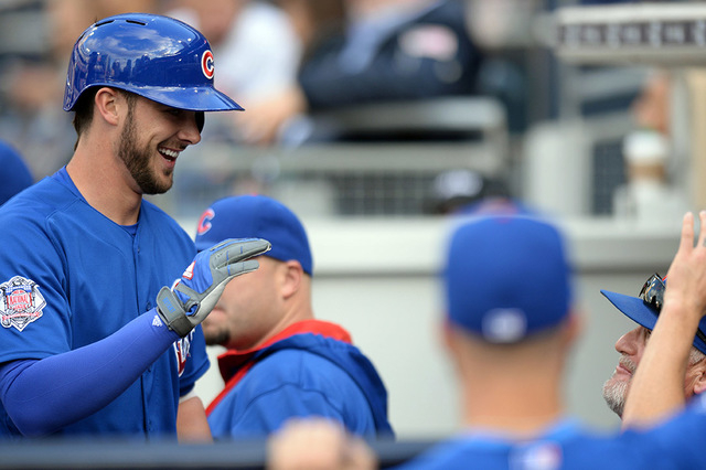 Chicago Cubs third baseman Kris Bryant is congratulated after hitting a two-run home run during the first inning against the San Diego Padres at Petco Park in San Diego, May 21, 2015. (Jake Roth-U ...