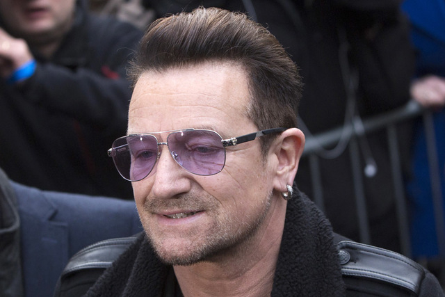 U2 lead singer Bono arrives for the recording of the Band Aid 30 charity single in west London November 15, 2014. (REUTERS/Neil Hall)