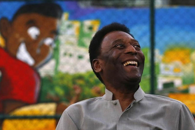 Brazilian soccer legend Pele laughs during the inauguration of a refurbished soccer field at the Mineira slum in Rio de Janeiro September 10. The 74-year-old soccer great had to cancel a book-sign ...