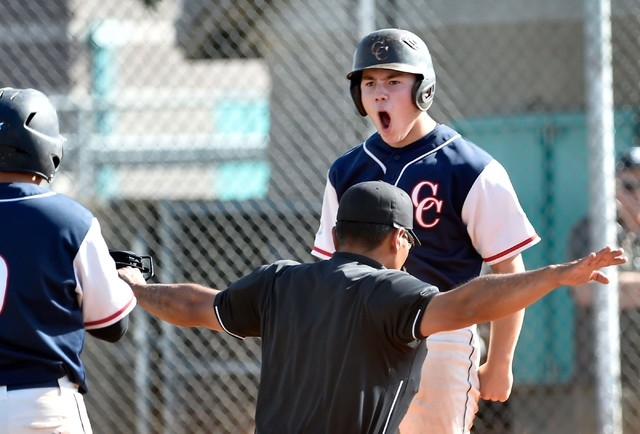 Coronado High School's Nate Ruiz reacts after sliding safely across homeplate during a first round game in the Sunrise Region baseball tournament against Silverado at Silverado High School on Tues ...