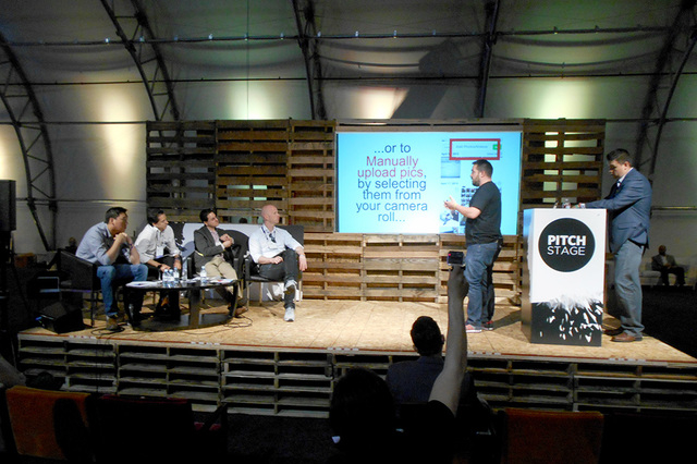 An unidentified startup company makes a pitch to unidentified investors at the Collision Conference at World Market Center on Tuesday, May 5, 2015. The conference was held to allow startup compani ...