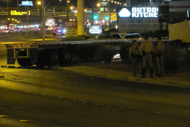 A tractor trailer rig is sideways, half off the road, following a collision with a taxi in the 4300 block of Dean Martin Drive on Wednesday, May 27, 2015. (Greg Haas/Las Vegas Review-Journal)