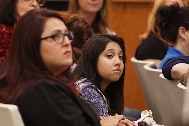 Kristina Hernandez, center, age 12 and a transgender Clark County student, attends a Clark County School Board meeting Thursday, May 28, 2015, in Las Vegas. Hernandez and her mother Laura, front l ...