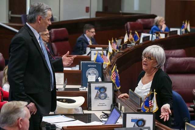 Nevada Sens. James Settelmeyer, R-Minden, and Debbie Smith, D-Sparks, discuss a bill that would allow ride-hailing companies like Uber and Lyft to operate in Nevada during a break in the Senate fl ...