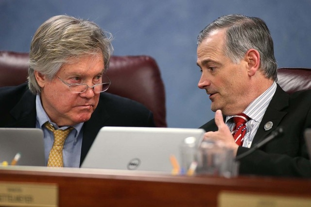 Nevada Sens. Tick Segerblom, D-Las Vegas, left, and James Settelmeyer, R-Minden, talk in a committee hearing at the Legislative Building in Carson City, Nev., on Monday, May 11, 2015. Earlier Mond ...