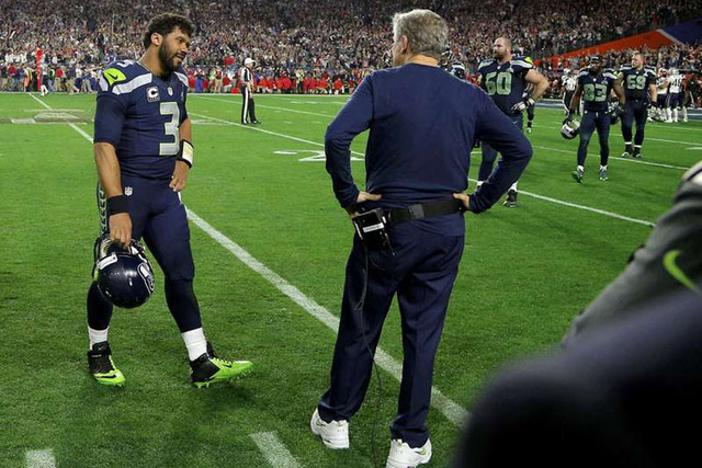 Seattle Seahawks head coach Pete Carroll and quarterback Russell Wilson (3) talk after being intercepted by New England Patriots strong safety Malcolm Butler in the final seconds of the NFL Super  ...