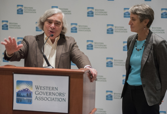 U.S. Department of Energy Secretary Ernie Moniz speaks during the 2014 Western Governors Winter meeting while U.S. Department of Interior Secretary Sally Jewell looks on at the Four Seasons Hotel  ...