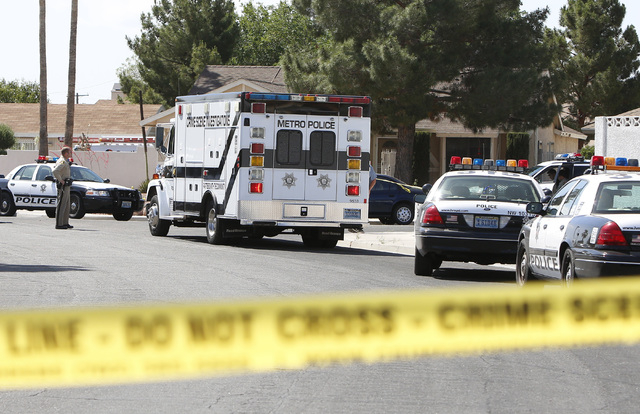 Metro police department's Crime Scene Investigation van is seen near the house where two people were wounded in a northwest valley shooting on Thursday, May 7, 2015 at the 5800 block of Westport C ...