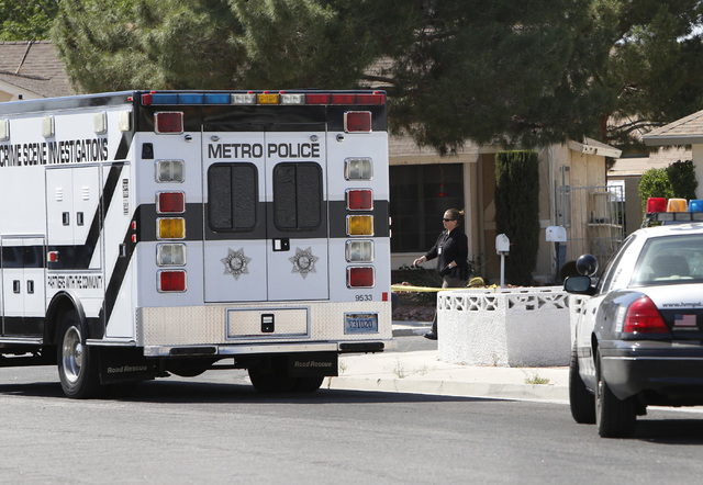 Metro's Crime Scene Investigation van is seen near the house where two people were wounded in a northwest valley shooting on Thursday, May 7, 2015, at the 5800 block of Westport Circle. (Bizuayehu ...