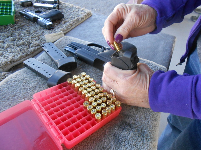 Karen S. (last name withheld) loads ammunition into her gun Jan. 9, 2015, at the Clark County Shooting Complex. (Jan Hogan/View)