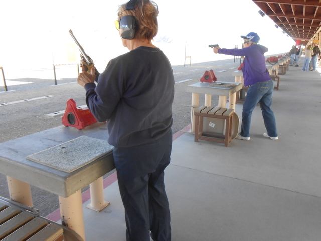 Karen S., left, and Judi R. (last names withheld) prepare to shoot Jan. 9, 2015, at the Clark County Shooting Complex. (Jan Hogan/View)
